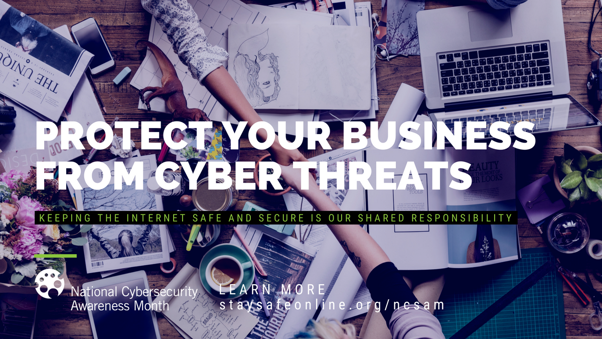 table with computer and papers - text overlay says protect your business from cyber threats